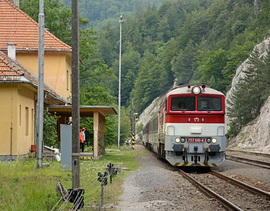 The line from Banská Bystrica to Vrútky is very scenic but dificult to get too as it is somewhat inaccessible. This is train 1851 the 14:54 Žilina to Banska Bystrica and it's passing Hermanec  Jaskyňa (which means cave in Slovak). Note the stationmaster in his peaked cap and, presumably, his wife in Hi Vis jacket. He put the cap on to observe the train passing. 010-4 is a class 757, rebuilt from the original CKD T478.