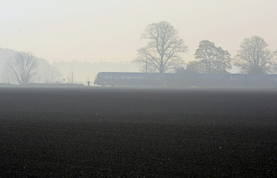 In the hazy morning light a King's Lynn to Ely ecs crossing the fields between King's Lynn and Watlington