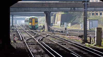 The 59 was followed by one of Southern's new class 377/6s on a train from either Tattenham Corner or  Caterham