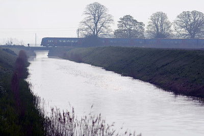 The 07:55 King's Lynn to King's Cross crossing Polver Drain on the approach to Watlington.