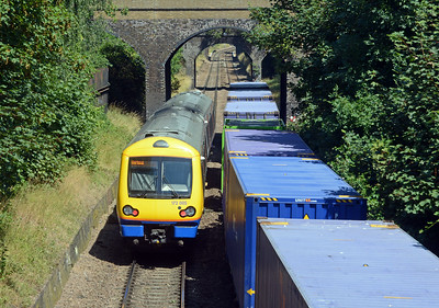 The rear of the train is passed by the 13:35 Gospel Oak to Barking