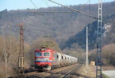 The second of the two sleepers from the Czech Republic to Košice was due to stop at Kysak at 07:57 and arrive in Košice at 08:11. So when at 08:07 the valley filled with the sound of an eastbound I was expecting the sleeper. But it wasn't going fast enough, and the signal behind me had simply changed to yellow, not green. But I wasn't expecting this, Lokorail AS  182 072-9 on what look like cement hoppers. Lokorail is one of a number of FOCs competing against incumbent ZSSK Cargo.