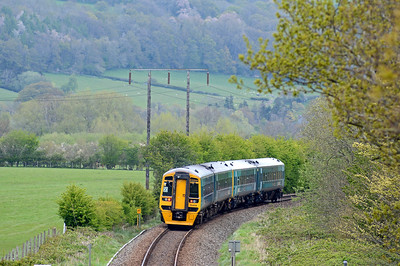 The going away shot is more open as the train heads down the valley of the River Severn towards Welshpool