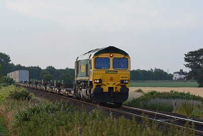 In the opposite direction 66534 on the 4E62 05:15 Felixstowe North to Doncaster Railport, plenty of empty flats with only 13 loads.